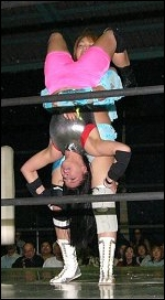 Ariel is about to be piledriven into the mat during her Japanese tour.